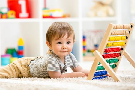 early education: kid playing with abacus