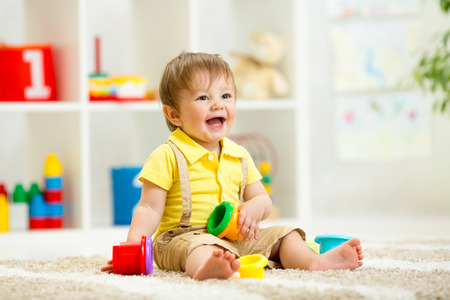 Funny little child playing with toys photo