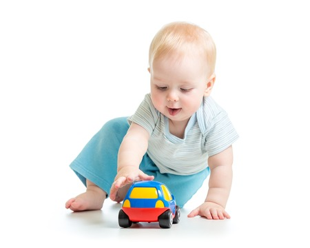 funny child kid playing with toy car photo