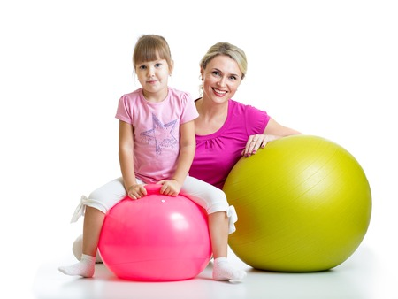 family exercise: kid girl  and mother with fitness ball Stock Photo