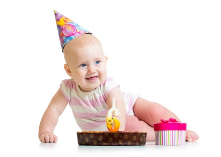 gifting: baby girl with birthday cake and gifting box