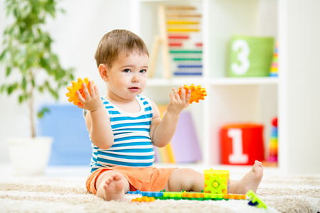 kid playing with block toys at home