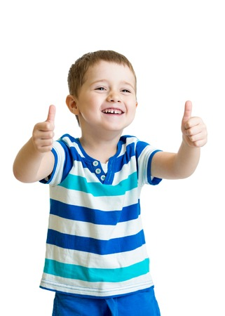 happy kid boy with hands thumbs up isolated on white photo