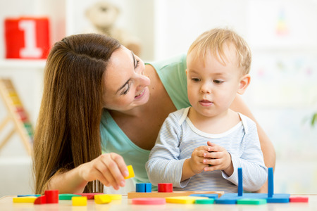 game block: little boy and mother play with building blocks
