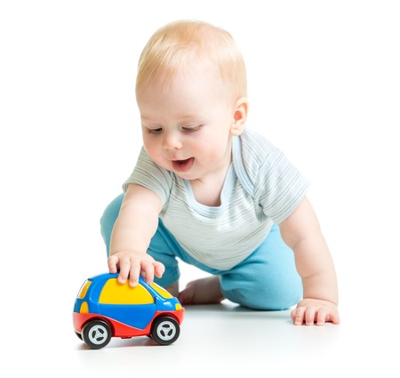 baby boy toddler playing with toy car isolated Stockfoto