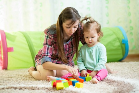 mother with his child daughter play together at home photo
