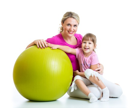 kids exercise: kid girl and mother with fitness ball