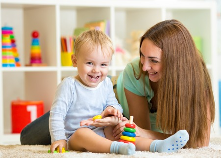 happy mother and child son playing together indoor at home photo