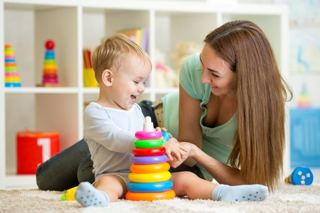 cute mother and child boy playing together indoor at home photo