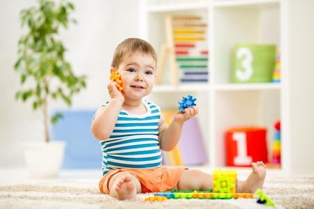 funny kid boy playing at home or at kindergarten Reklamní fotografie