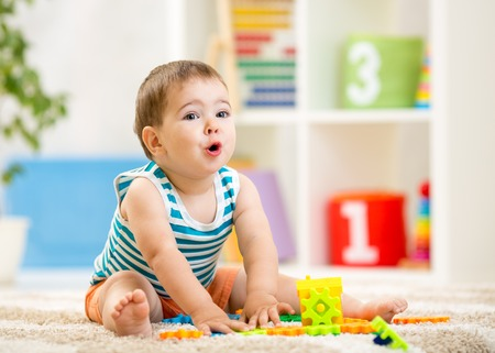 kid boy playing with block toys indoor Stock Photo - 33401385