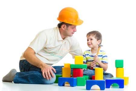 kid boy and dad play builders isolated on white photo