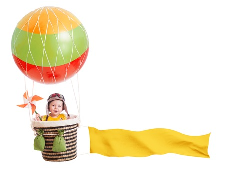 cheerful child girl on hot air balloon isolated on white background