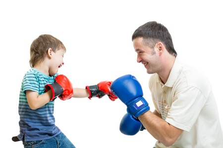 kid boy and father play with boxing gloves photo