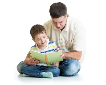 kid boy and his dad read a book together Stock Photo