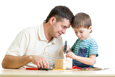 Man and kid child boy tinkering nesting box together photo
