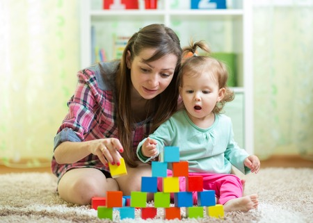 mom with her child daughter play together at home photo