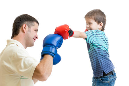 health care fight: father and kid son play with boxing gloves Stock Photo