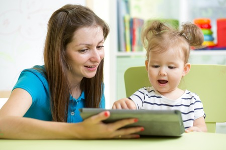 mother and her child with tablet pc photo