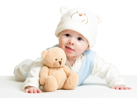 baby boy weared funny hat with bear plush toy