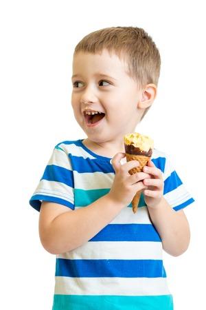 happy kid boy eating ice-cream in studio isolated on white photo