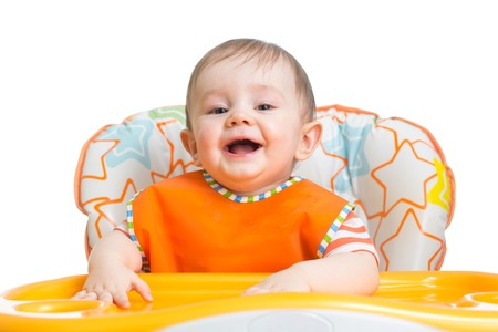 highchair: cheerful happy baby child waiting for food Stock Photo