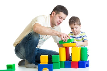 toy blocks: kid and his dad playing with building blocks