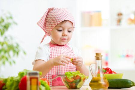cook kid girl preparing healthy food vegetables Stock Photo