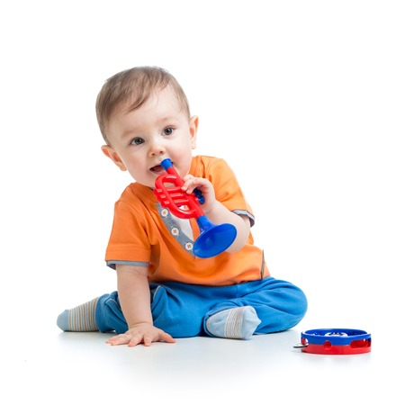 babies playing: kid playing  with musical toy isolated on white