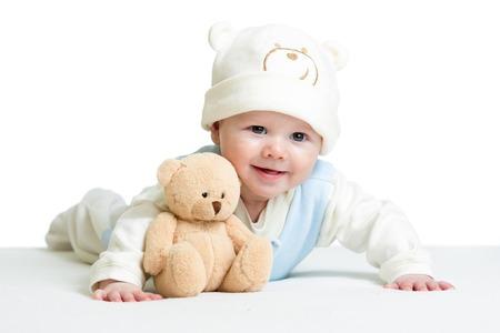 嬰兒: 男嬰weared滑稽的帽子帶毛絨玩具 版權商用圖片