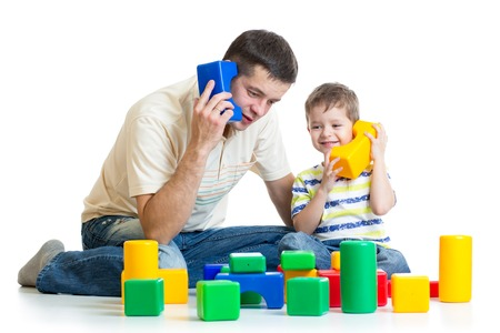 toy phone: father and child son role playing isolated