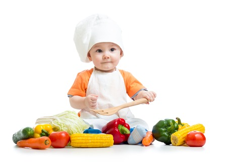 Baby cook with fresh vegetables isolated on a white