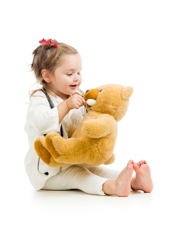 child dressed as doctor playing with toy isolated photo