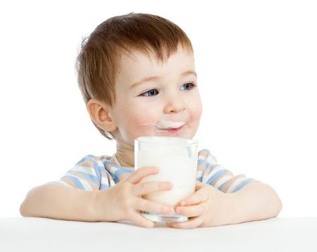 child boy drinking milk or yogurt from glass