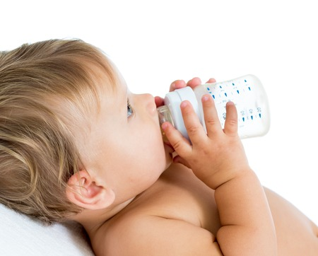 ot: baby holding bottle and drinking milk ot water