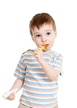 Child kid boy brushing teeth isolated on white photo