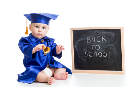 prodigy: funny baby with bell in academician clothes at chalkboard isolated