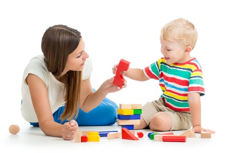 kid boy playing toys together with mother photo
