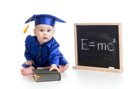 prodigy: funny child with book in academician clothes at chalkboard isolated Stock Photo