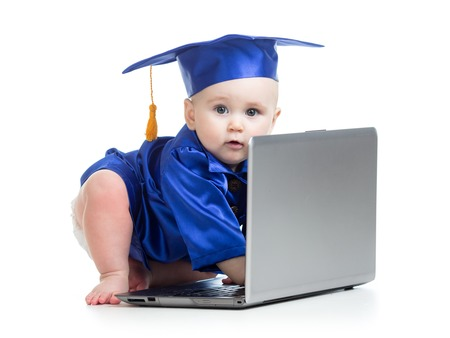 prodigy: funny baby girl in academician clothes at laptop