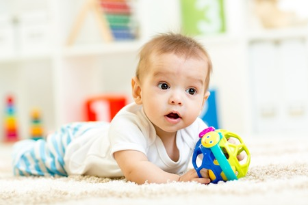 little boy playing with toy indoor at nursery