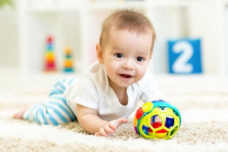 baby boy playing with toys indoors at home Stock Photo
