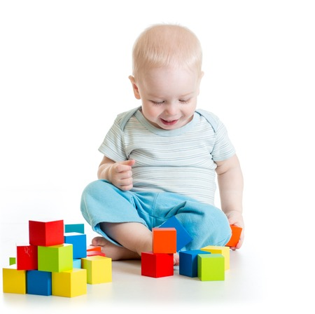 play blocks: kid toddler playing  wooden toy blocks isolated