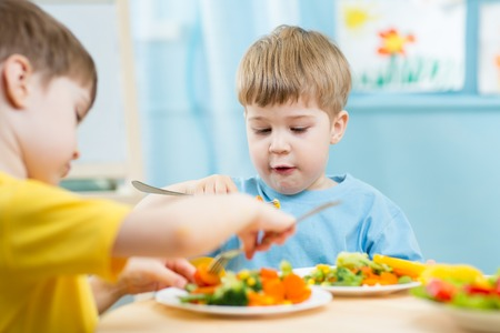 hungry kid: kids eating food in nursery or at home