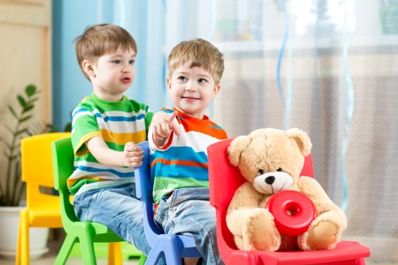 imitations: Two cute little boys playing role game in daycare Stock Photo