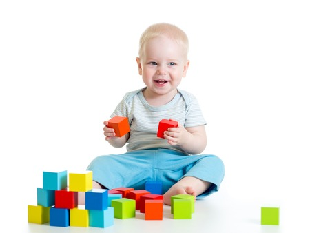 toddler child boy playing  wooden toy blocks isolated photo
