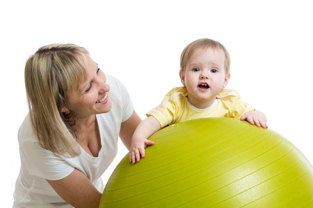 fit ball: mother playing with baby on fit ball