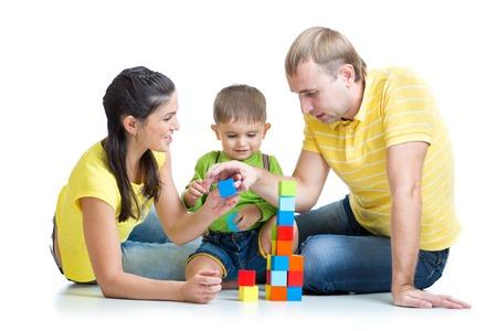 play blocks: kid and his family play building blocks Stock Photo