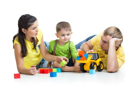 play blocks: happy family - little boy and parents play building blocks