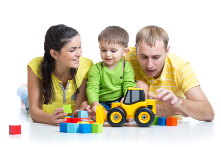 play blocks: happy family - toddler boy and parents playing building blocks